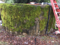 Moss-covered water tank