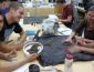 Students analyzing soil samples in a laboratory