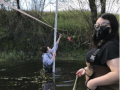 students take measurements in a creek